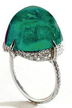 Cartier ring featuring a very large columbian emerald and pave-set diamonds, platinum. c. 1920 by cecile
