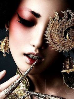 Chinese art / opera ….with a rosy glow. TG