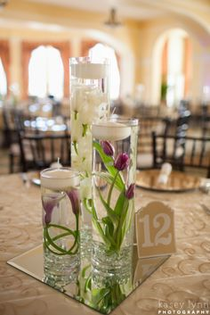 Submerged Flower Centerpieces. White Orchid, purple tulips and purple calla lilies