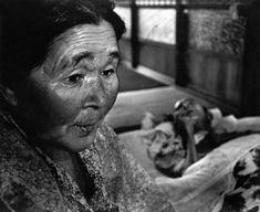 JAPAN. Minamata. Mrs HAYASHIDA with her dying husband. They both suffer from mercury poisoning. 1971.