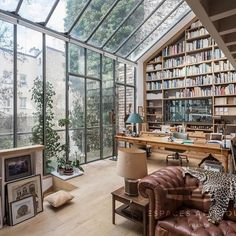 The grandest bookcase I've ever seen in a home office space with beautiful floor to ceiling windows letting the light poor in #office #bookshelf