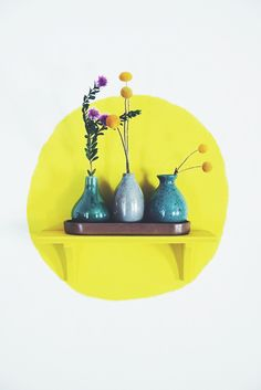 Painted Yellow dot behind matching floating shelf (West-side living room makeover: sneak peek)