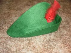 This pirate green Peter Pan Hat with bright red feather is made of high quality felt and Pellon. The rim can be adjusted slightly to re-size. Recommended for children from age 2 to 8.  This item is ready to ship
