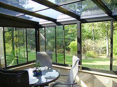 solarium and beautiful backyard