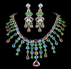 Dazzle Necklace and Earring Set. Accompanied by 180.61 carats of Morganite, Tsavorite and Aquamarine. Set in 18 karat Yellow Gold.