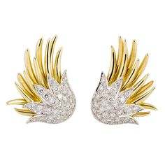 Tiffany & Co. 18k and platinum diamond earrings, $11,000 from Botier