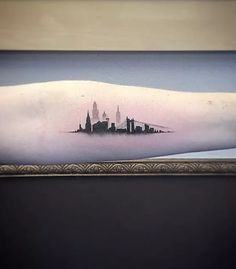 Little Tattoos — Single needle New York skyline tattoo on the left. New York Tattoo, Nyc Tattoo, City Tattoo, Ny Skyline Tattoo, Nyc Skyline, Milwaukee Skyline, Atlanta Skyline, Little Tattoos, Small Tattoos