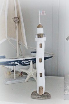 Driftwood lighthouse handcrafted from gathered driftwood & beach treasures off the shores of our local beach. Each of my lighthouses are one of a kind! Unique décor for beach theme home. Costal design with a whimsical flare.