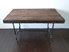 reclaimed wood desk or table with industrial black pipe base. $650.00, via Etsy.