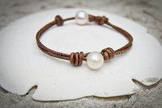 Baroque white pearls and distressed-looking leather make this bracelet both glamorous and rugged. I love the understated elegance of the