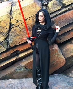 Forgive me father, for I have sithed.😈☠😈 I kind of had the most fun ever yesterday, especially since I kept running into this little girl dressed as Rey who would draw her lightsaber at me & it's been making me laugh all day just thinking about it. - Also this romper dress from @shoplostgeneration was the perfect Kylo Ren number, don't forget you can use my code: Damfino25 and save on some perfect Disneyland ready pieces! #seasonoftheforce