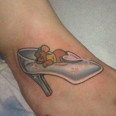 Glass Slipper tattoo.. I love Gus Gus but he'll have to be nixed. maybe add some glowing light around the slipper.