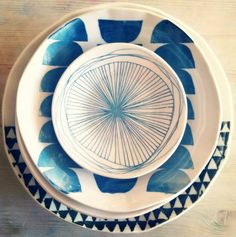 etsy:  MADE by mbartstudios set of 8 screenprinted porcelain dishes.