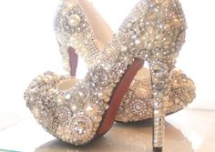 I WANT these crystal, glass and pearl covered high heels. #theperfectweddingshoe