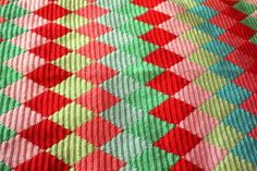 I love the colors and the stitchery via littlewoollie.blogspot.com