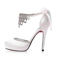 Rhinestones and satin, nothing says wedding more than these shoes!