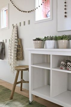 This post is sponsored by IKEA. Use our ideas to organize your hallway, and avoid having your entryway be an obstacle course. Do you have a mudroom? And by mudroom I mean a place to put jackets and bags and school work and backpacks and. Ikea Hallway, Front Hallway, Entryway Furniture, Diy Furniture, Ikea Hooks, Ikea Side Table, Cubby Shelves, Cubbies, Entry Way Design