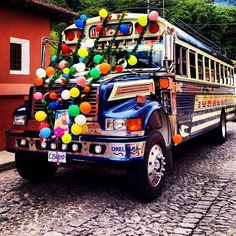 This chicken bus is all decked out! #Guatemala www.coeduc.org