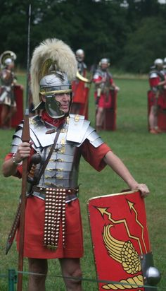 Imperial Legionary, 1st cent. CE, wearing the famous band armour, the lorica segmentata and holding a pilum.