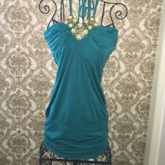 Beautiful Green top Beautiful Green embellished top.  Very flattering on Love and Love Tops Tunics
