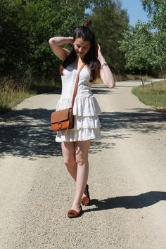 For a look that provides functionality and chicness, consider wearing a white peasant dress. Avoid looking too casual by finishing with a pair of brown suede tassel loafers. Brown Leather Crossbody Bag, Crossbody Bags, Tassel Loafers, Brown Suede, Looking For Women, Ballet Flats, Rock, Elegant, Simple