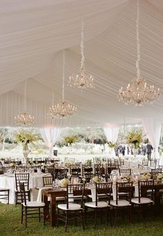 outdoor tented wedding reception ideas with chandeliers decorated