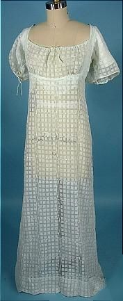 Embroidered sheer woven muslin trained gown. 1800. Embroidered transparent evening dress with train, likely English or French. $ 2,250.