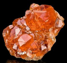 Super gemmy Hessonite Garnet from the Jeffrey Quarry, Asbestos, Les Sources RCM, Estrie, Québec, Canada.  Credit: The Mineral Gallery, Inc.