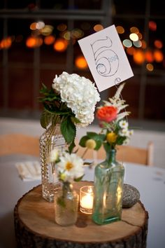 Table centre-piece idea. Hand-drawn table numbers // photo by NinePhotography.com