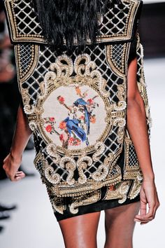 Over the top embellishments on jacket and skirt