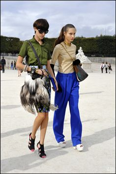 Blue pleated, loose pants. Must be able to pull it off.
