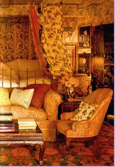 The master bedroom:  paisley covered sofa and chairs.  Oriental coffee table.   Wallpaper, and indienne inspired fabric on the four poster bed. Lynn Von Kersting