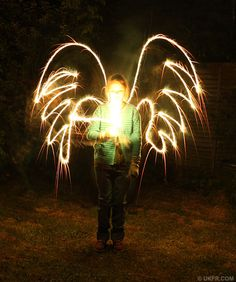 Drawing angels with sparklers!!! Love this stuff...