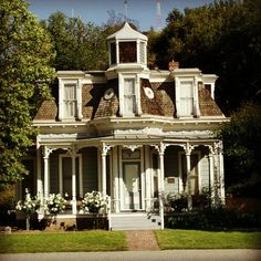 cocobabydoll: I want a pretty pale blue house with a porch around the entire place and I want pale pink flowers lining the front path, ooh and a white picket fench of course! #victorian #house #aintitadream (Taken with Instagram)