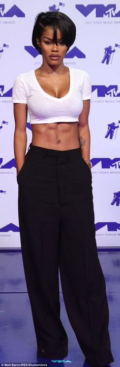Ab-tastic: Teyana Taylor flaunted her toned torso in a white crop top with flowy trousers