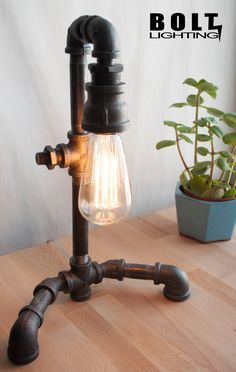 """Industrial Pipe Lamp With Old Fashioned Light Bulb """"The Intellectual"""". $115.00, via Etsy."""