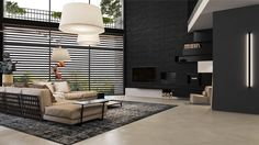 Light and dark can contrast without using monotones. This architecturally-envisaged space lets in light through black Venetian blinds, while black, mock-iron wall panels make their mark. An almost-golden couch area provides a softer touch, while its waffle-backing and vertical single light tie the themes together.