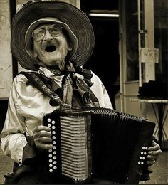 Old Woman Playing the Accordian.