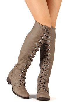 Walk on the edge of fashion with this stylish boot! Featuring round toe, perforated detail, leather lace up front design, elastic gusset insert at the back, and block heel. Finished with cushioned insole, soft interior lining, and partial side zipper closure for easy on/off.