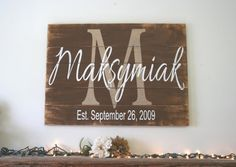 This is a wood pallet sign that comes in two different sizes - 24 x 16 and 30 x 22.  The background is painted Melted Chocolate. Initial is Tan