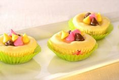These Springtime Cheesecake Nibbles are the ideal dessert for any spring get-together. Decorated with colorful morsels, they are perfectly bite-sized and can be made ahead of time.