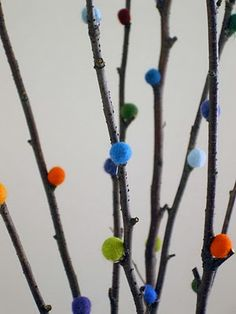 For a splash of color in a vase - DIY rainbow-colored faux pussy willow branches!
