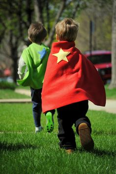 Use sticky-back velcro strips and fabric glue. Pre-cut appliques (stars, hearts, lightning bolts) and felt capes. Kids can choose the colors, secure velcro, and glue on the applique.