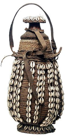 Africa | Milk storage vessel from Ethiopia. They are made from gourds covered in basketry, mud/clay, leather and adorned with cowrie shells | © Tim Hamill