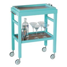 $436 -- I want this for my Turquoise painted office!  The Avalon bar cart keeps cocktail necessities at the ready in slick style. Bold in a bright pop of turquoise accented with silver hardware, this piece rolls with contemporary charisma in dining rooms and living rooms alike.