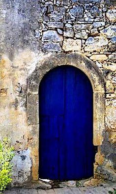 Blue door in Crete village in  Greece.
