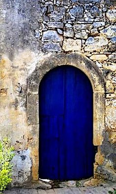 Blue door in Crete village in Greece.