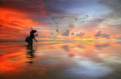 Sunrise Catch by Alit Apriyana, via 500px