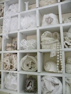 Lace scraps organized in cubbies. Great way to organize your supplies.