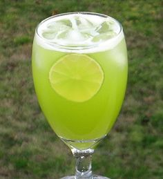 Mountain Dew Me (2 oz. Melon Liqueur 1 oz. Triple Sec 4 oz. Pineapple Juice 1 oz. 7-Up Lime wheel for garnish).